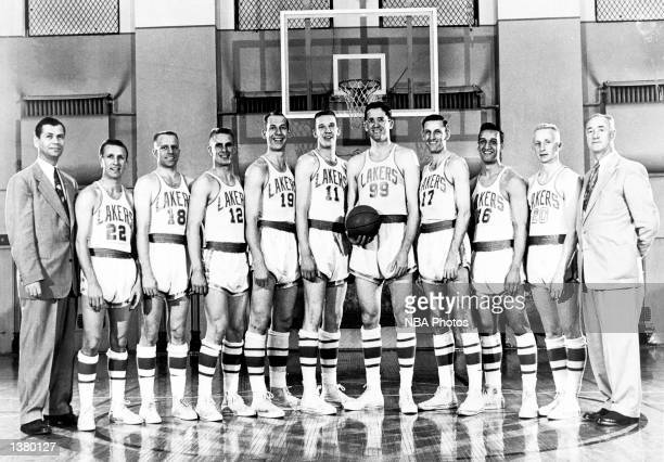 The World Champions of basketball Minneapolis Lakers pose for a team portrait Head Coach John Kundla Slater Martin Frank Saul Jim Holstein Vern...