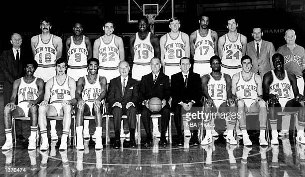 The World Champions of basketball New York Knickerbockers pose for a team portrait seated John Warren Don May Walt Frazier President Ned Irish...