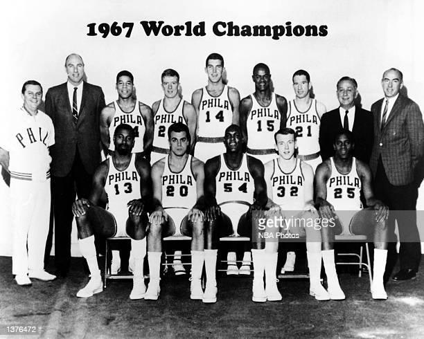 The World Champions of basketball Philadelphia 76ers pose for a team portrait front row Wilt Chamberlain Dave Gambee Luke Jackson Billy Cunningham...