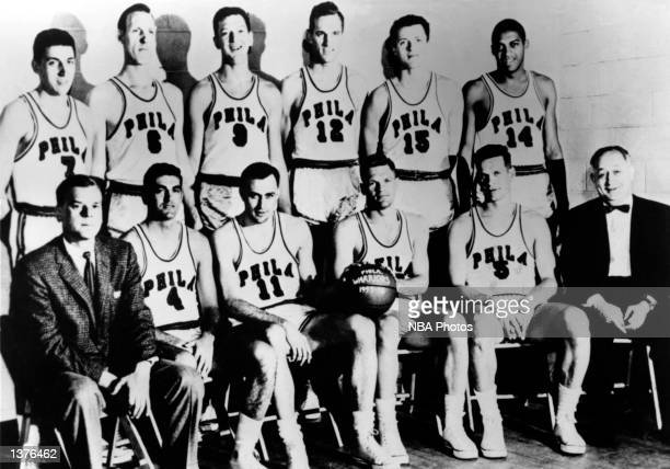 The World Champions of basketball Philadelphia Warriors pose for a team portrait front row head coach George Senesky Larry Hennessy Paul Arizin Jack...