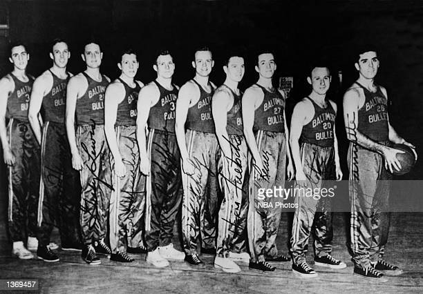 The World Champions of basketball the Baltimore Bullets pose for a team portrait in 1948 starting from Connie Simmon Clarence Hermsen Grady Lewis...