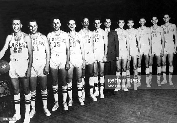 The World Champions of basketball the Minneapolis Lakers pose in 1950 for a team portrait starting from Slater Martin Billy Hassett Don Carlson Herm...