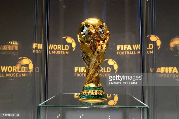 The World Cup trophy is seen in the FIFA World Football Museum during its inauguration on February 28 2016 in Zurich Newlyelected FIFA president...