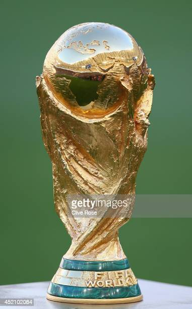 The World Cup trophy sits on display prior to the 2014 FIFA World Cup Brazil Final match between Germany and Argentina at Maracana on July 13 2014 in...