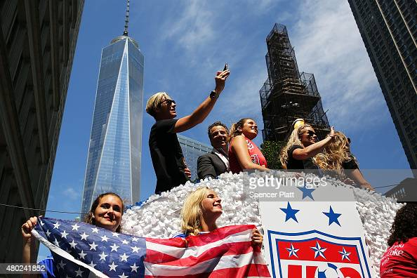 The World Cupwinning US women's soccer team including Abby Wambach celebrates along with New York Governor Andrew Cuomo as they make their way up the...