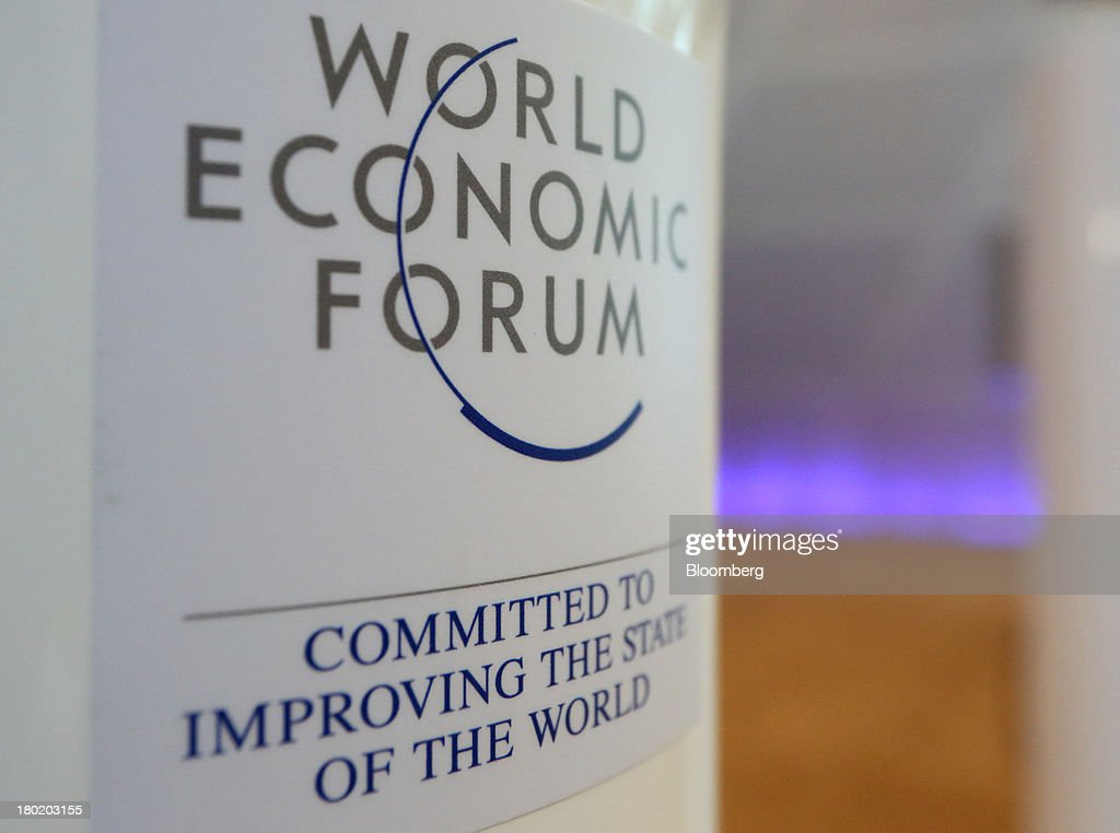 The World Economic Forum logo is displayed at the Dalian International Conference Center in Dalian, China, on Tuesday, Sept. 10, 2013. The World Economic Forum Annual Meeting Of The New Champions 2013 will be held in Dalian from Sept. 11 to 13. Photographer: Tomohiro Ohsumi/Bloomberg via Getty Images