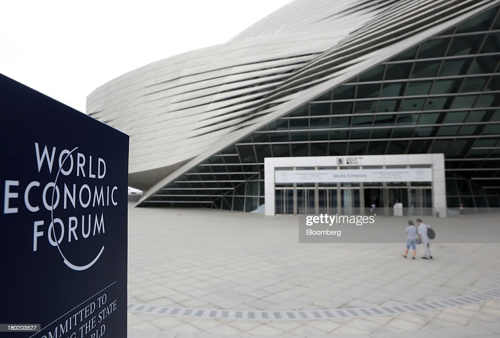The World Economic Forum logo is displayed on a sign outside the Dalian International Conference Center in Dalian, China, on Tuesday, Sept. 10, 2013. The World Economic Forum Annual Meeting Of The New Champions 2013 will be held in Dalian from Sept. 11 to 13. Photographer: Tomohiro Ohsumi/Bloomberg via Getty Images