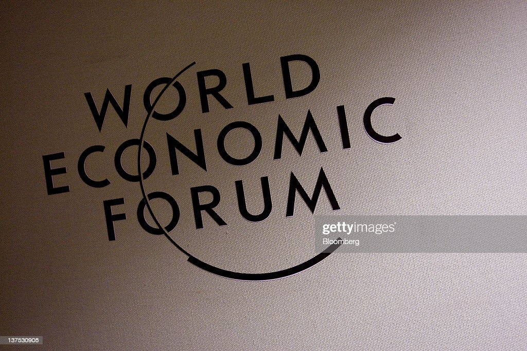 The World Economic Forum's (WEF) logo is displayed inside the Congress Centre, the venue of the World Economic Forum's 2012 annual meeting, in the town of Davos, Switzerland, on Sunday, Jan. 22, 2012. German Chancellor Angela Merkel will open next week's World Economic Forum in Davos, Switzerland, which will be attended by policy makers and business leaders including U.S. Treasury Secretary Timothy F. Geithner. Photographer: Scott Eells/Bloomberg via Getty Images