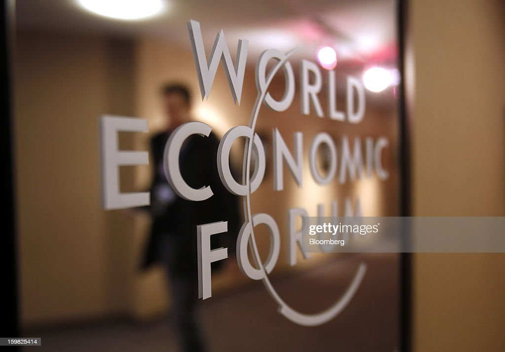 The World Economic Forum's (WEF) logo is displayed on a mirror inside the Congress Centre ahead of the WEF meeting in Davos, Switzerland, on Monday, Jan. 21, 2013. This week the business elite gathers in the Swiss Alps for the 43rd annual meeting of the World Economic Forum in Davos, the five day event runs from Jan. 23-27. Photographer: Simon Dawson/Bloomberg via Getty Images