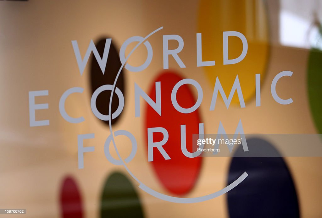 The World Economic Forum's (WEF) logo is displayed on a window inside the Congress Centre ahead of the WEF meeting in Davos, Switzerland, on Sunday, Jan. 20, 2013. Next week the business elite gathers in the Swiss Alps for the 43rd annual meeting of the World Economic Forum in Davos, the five day event that will run from Jan. 23-27. Photographer: Chris Ratcliffe/Bloomberg via Getty Images