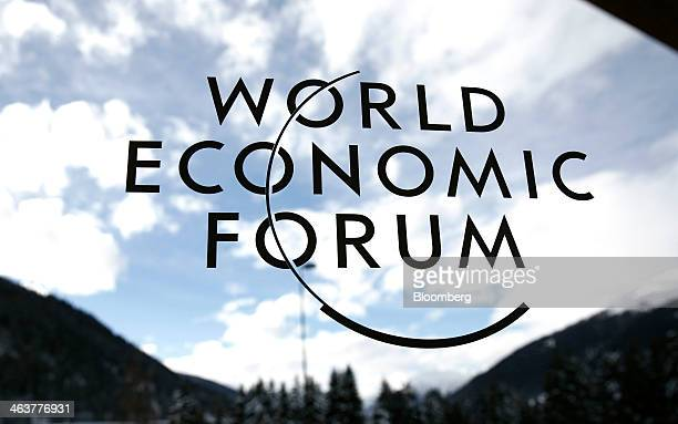 The World Economic Forum's logo is displayed on a window inside the Congress Center ahead of the meeting in Davos Switzerland on Sunday Jan 19 2014...