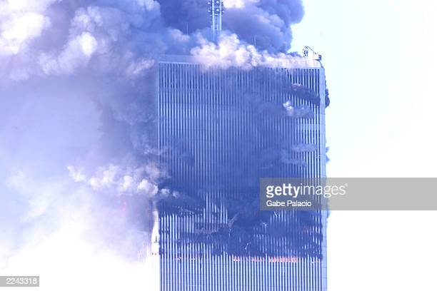 The World Trade Center burning after two airliners crashed into the buildings in New York City Tuesday September 11 2001 Photo by Gabe...