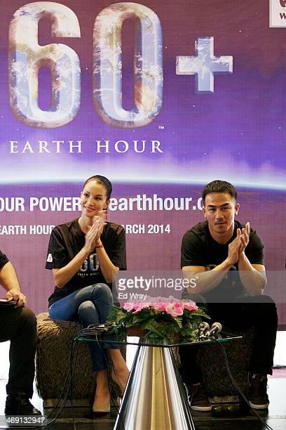 The World Wildlife Fund's Earth Hour Global Ambassador Nadya Hutagalung and WWF Tiger Warrior Joe Taslim applaud after Spiderman was named the new...
