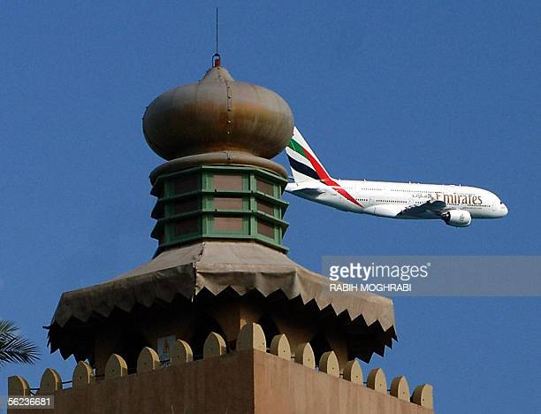 The World's biggest passenger jet Airbus A380 superjumbo bearing a belly logo of the national carrier Emirates and the flag of UAE on its tail flies...