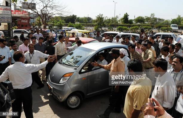 The world's cheapest car the Tata Nano is driven up to the Cargo Motors showroom for public display in Ahmedabad on April 1 2009 The Nano dubbed 'the...