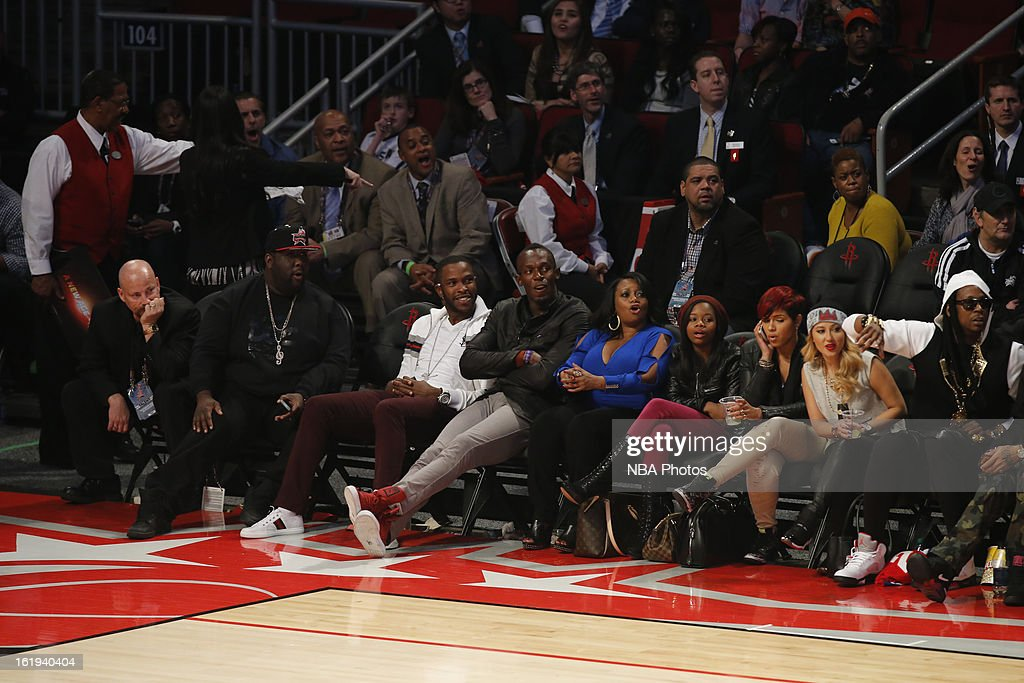 The Worlds fastest man Usain Bolt watches the game from the sidelines during 2013 NBA All-Star Game on February 17, 2013 at Toyota Center in Houston, Texas.