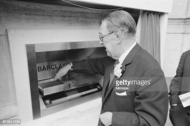 The Worlds First ATM Cash Machine is unveiled at Barclays Bank in Enfield Middlesex just North of London 27th June 1967 Picture shows a customer...