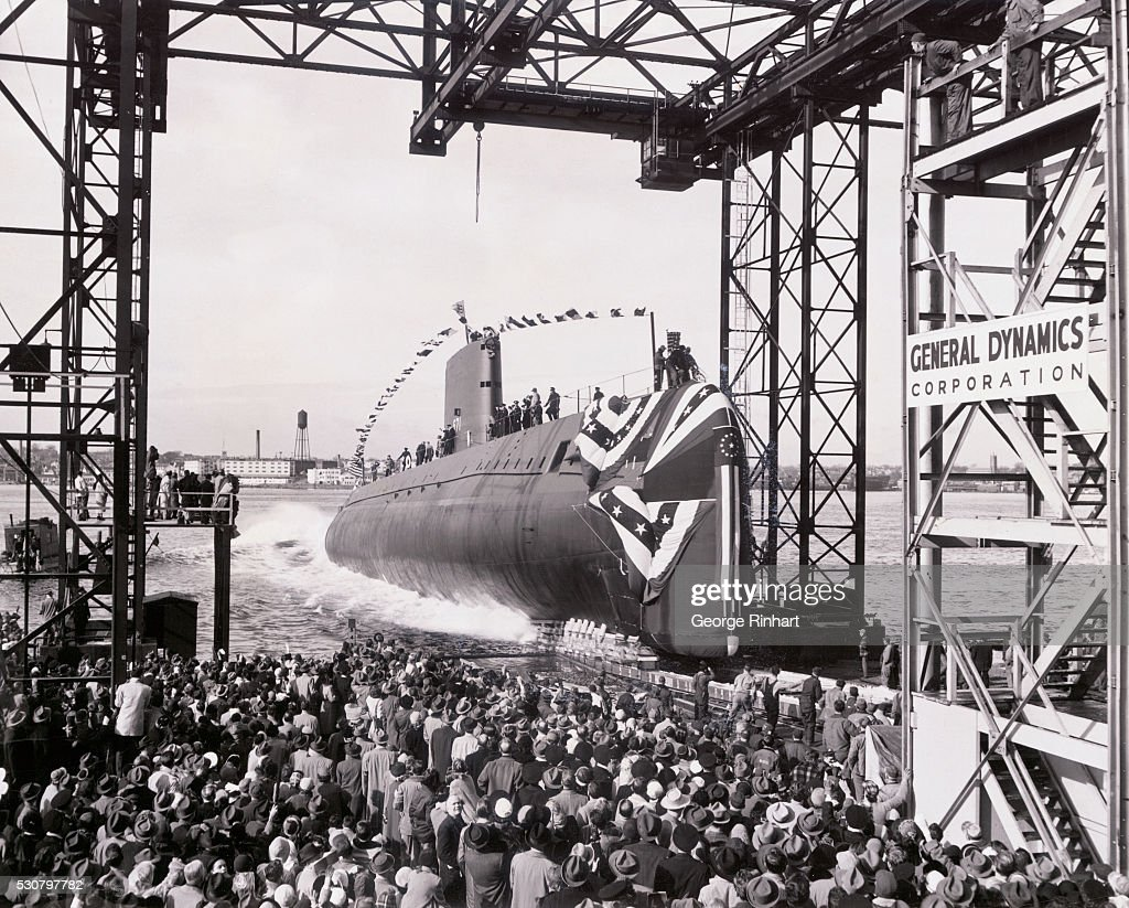 The world's first nuclear powered submarine the USS Nautilus enters the waters of the Thames River at her launching here from shipyard of Electric...