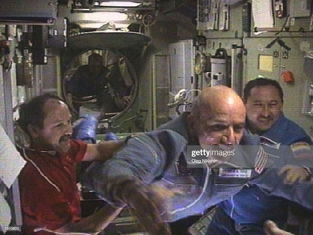 The worlds first space tourist Dennis Tito, center, flies into the International Space Station as Russian Talgat Musabayev, right, looks on and the station''s Russian commander Yuri Usache welcomes them, April 30, 2001. Tito and the two Russian cosmonauts Musabayev and Yuri Baturin accompanying him will spend a week as guests of Usachev and his two American crewmates on board the ISS. (Photo by RTV/Oleg Nakishin/Newsmakers