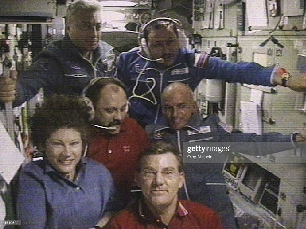 The worlds first space tourist Dennis Tito poses with the International Space Station crew shortly after his arrival to the station April 30, 2001 in this image from television. Clockwise from bottom left are U.S. astronaut Susan Helms, Russian cosmonauts Yuri Usachev, Yuri Baturin and Talgat Musabayev, U.S. space tourist Dennis Tito, U.S. astronaut Jim Voss. (Photo by RTV/Oleg Nakishin/Newsmakers