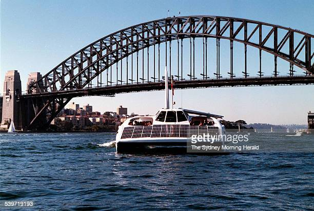 The world's first wind and sun powered ferry 'The Solar Sailor' designed by Dr Robert Dane heads towards the Sydney Harbour Bridge 25 June 2000 SMH...