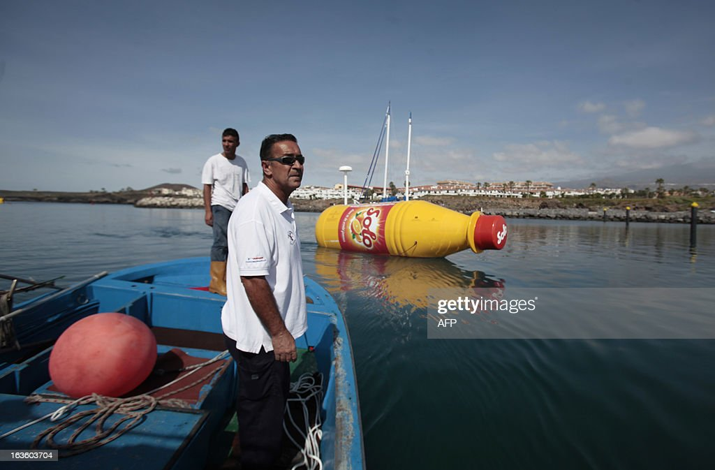 The world's largest message-in-a-bottle is released to the ocean in Santa Cruz de Tenerife on March 13, 2013. The 8 meter long bottle, which contains a case of Norwegian soft orange drink and a 12 square meter letter, is equipped with navigation lights required for a drifting object in international waters, solar panels, satellite-communications, tracking technology and a custom camera.