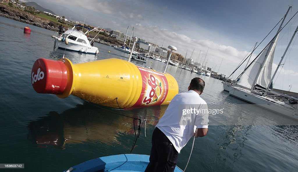 The world's largest message-in-a-bottle is released to the ocean in Santa Cruz de Tenerife on March 13, 2013. The 8 meter long bottle, which contains a case of Norwegian soft orange drink and a 12 square meter letter, is equipped with navigation lights required for a drifting object in international waters, solar panels, satellite-communications, tracking technology and a custom camera. AFP PHOTO / DESIREE MARTIN