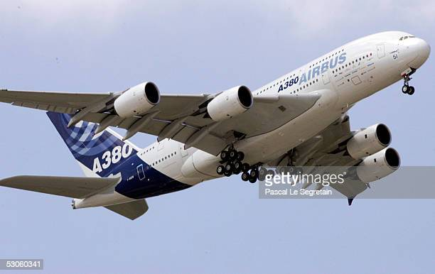The worlds largest passenger liner the Airbus A380 flies on display at the Paris Airshow June 13 2005 in the Paris suburb of Le Bourget France The...