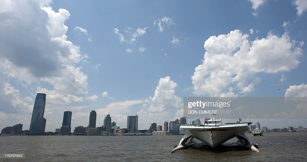 The worlds largest solar boat, Switzerlands MS Turanor PlanetSolar, arrives at North Cove marina near the World Trade Center June 17, 2013 in New York. The DeepWater Expedition, with scientists on board from the University of Geneva, is collecting climate change related data along the Gulf Stream. AFP PHOTO/Don Emmert