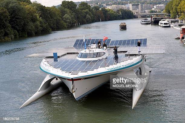 The world's largest solarpowered boat Turanor PlanetSolar sails on the Seine river in Paris on September 10 2013 The catamaran powered exclusively by...
