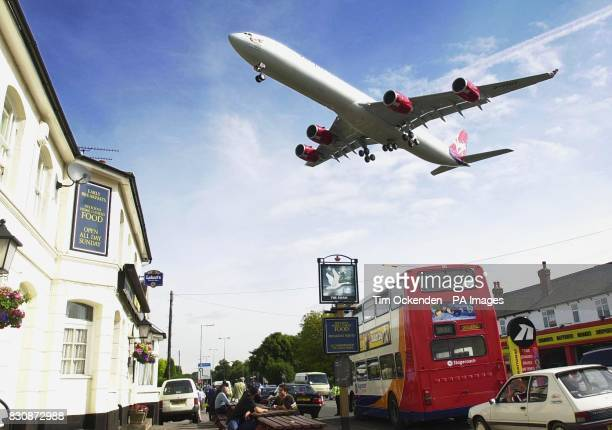 The world's longest passenger aircraft an Airbus A340600 in Virgin Alantic livery arrives for the first day of the Farnborough Air Show At 247ft long...