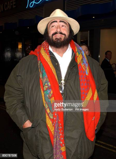 The world's most popular tenor Luciano Pavarotti poses for photographs outside the stage door at the Royal Opera House in London's Covent Garden...
