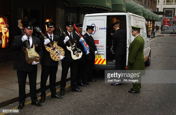 The Worlds most valuable electric guitars arrive in a security van at Harrods central London as security guards hold Rory Gallagher's signature 1961...