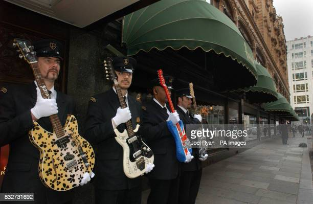 The Worlds most valuable electric guitars arrive in a security van at Harrods central London as security guards hold Keith Richards custom guitar...