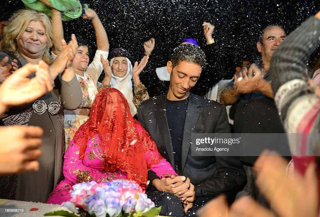 The World's tallest man Sultan Kosen and his fiancee Merve Dibo during their henna night, the ceremony held one day before the wedding, on October 26, 2013 in the Dede village of Mardin, Turkey. The World's tallest man, whose height is measured at 2 meters 51 centimeters, Sultan Kosen is set to marry Merve Dibo of Syrian descent on October 27, 2013 in the southern Turkish city of Mardin. In addition to his height, Kosen also entered the Guinness Book of World Records due to the size of his hands and feet, which are recorded at 27.5 centimeters and 36.5 centimeters respectively.
