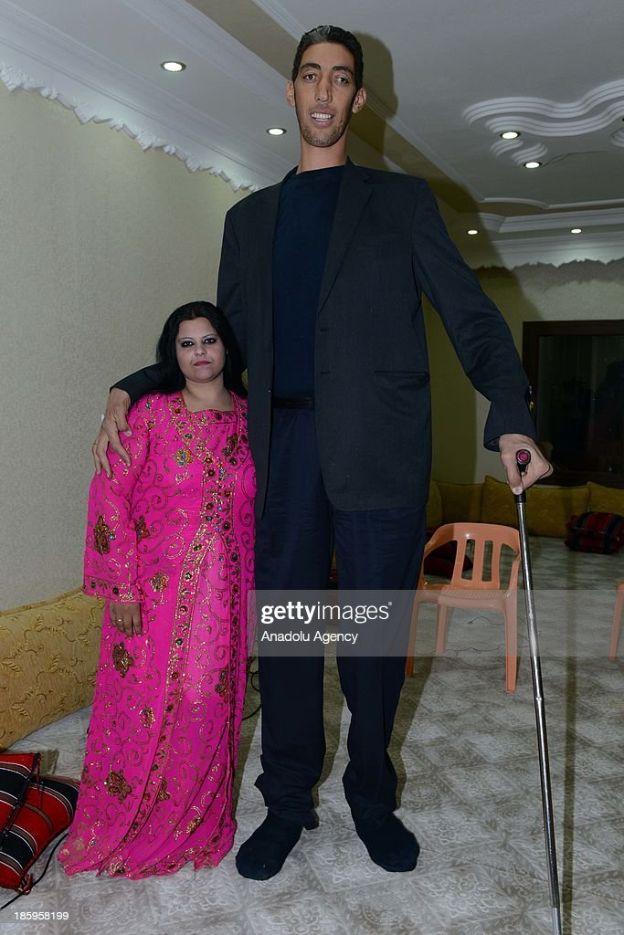 The World's tallest man Sultan Kosen (R) poses with his fiancee Merve Dibo during their henna night, the ceremony held one day before the wedding, on October 26, 2013 in the Dede village of Mardin, Turkey. The World's tallest man, whose height is measured at 2 meters 51 centimeters, Sultan Kosen is set to marry Merve Dibo of Syrian descent on October 27, 2013 in the southern Turkish city of Mardin. In addition to his height, Kosen also entered the Guinness Book of World Records due to the size of his hands and feet, which are recorded at 27.5 centimeters and 36.5 centimeters respectively.