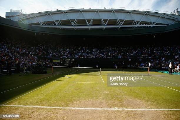 The worn grass on Centre Court during day twelve of the Wimbledon Lawn Tennis Championships at the All England Lawn Tennis and Croquet Club on July...
