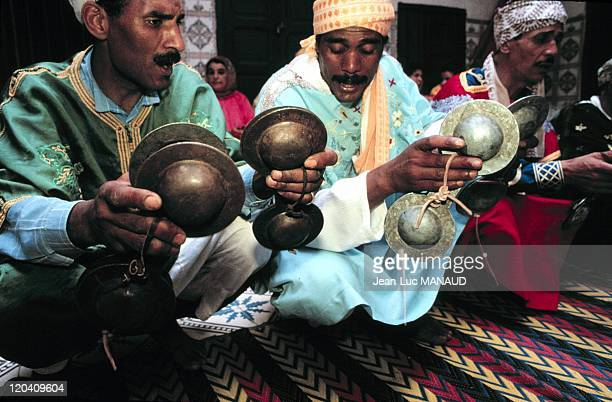 The worship of Genius the Gnawa in Morocco Musicians play with Karkeba iron castanets calling the world of spirits their rythms will reach the pace...