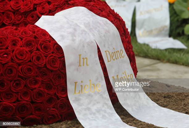 TOPSHOT The wreath from widow of former German Chancellor Helmut Kohl Maike KohlRichter reading 'In Love Your Maike' is pictured at the grave of late...