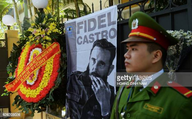 TOPSHOT The wreath of Vietnam Communist Party Secretary General Nguyen Phu Trong is seen placed next to a large portrait of Fidel Castro posted in...