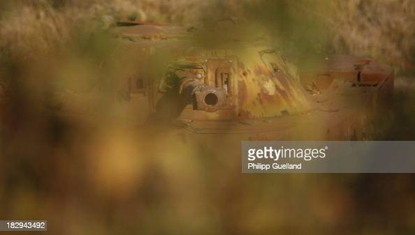The wreck of a discarded tank is seen on a firing range during the annual military exercises held for the media at the Bergen military training...