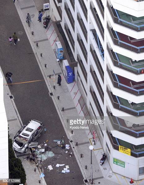 The wreckage is shown of a car which drove off the fifth floor of a parking garage with five people inside in Yokosuka Kanagawa Prefecture in this...