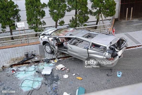 The wreckage is shown of a car which drove off the fifth floor of a parking garage in Yokosuka Kanagawa Prefecture on Dec 31 2016 with five people...
