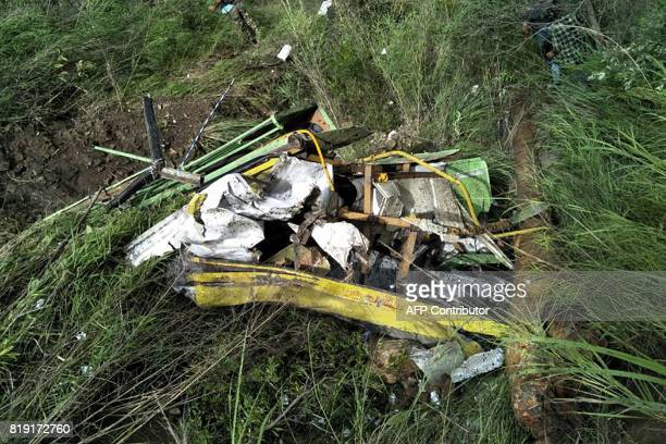 The wreckage of a bus lies in a gorge following an accident near the Indian town of Rampur on July 20 2017 At least 28 people were killed July 20...