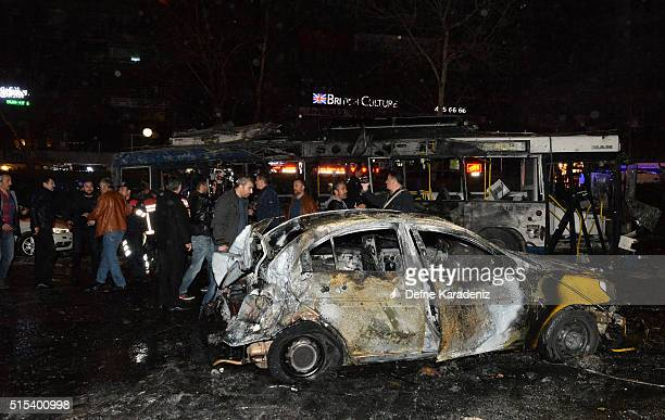 The wreckage of a car and a bus is seen after an explosion in Ankara's central Kizilay district on March 13 2016 in Ankara Turkey The Ankara...