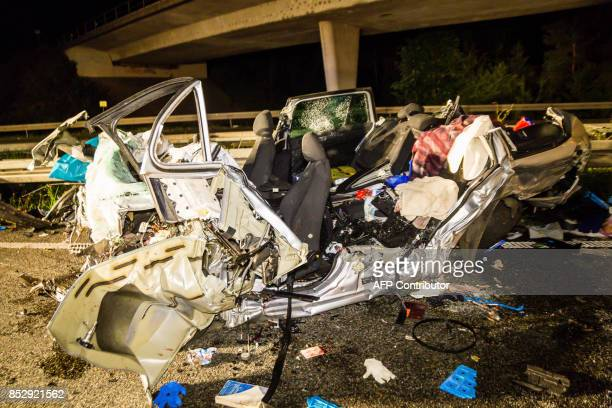 The wreckage of a car involved in an accident is pictured on September 23 2017 on the motorway A67 near Ruesselsheim western Germany where a wrongway...