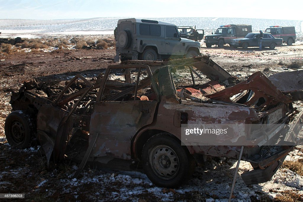 The wreckage of a car is seen at the site of an explosion in the village of Sbouba east of Baalbek in Lebanon's Bekaa valley, on December 17, 2013. A car exploded near a Hezbollah checkpoint in eastern Lebanon early in the morning, causing both deaths and injuries, a security source told AFP on condition of anonymity. AFP PHOTO/STR