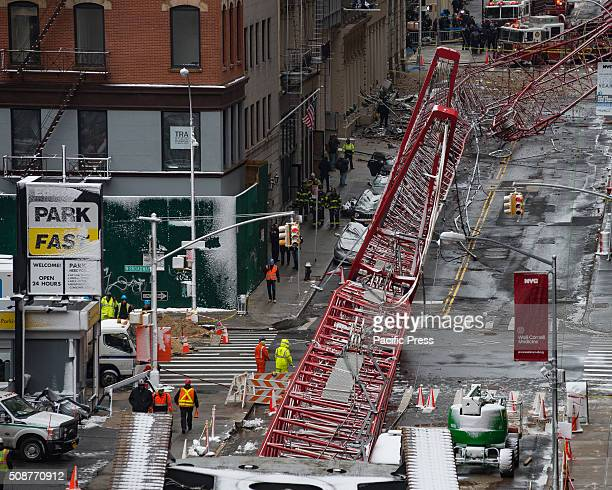 The wreckage of a construction crane fills two city blocks on Worth Street One person was killed and fifteen others were injured when a construction...