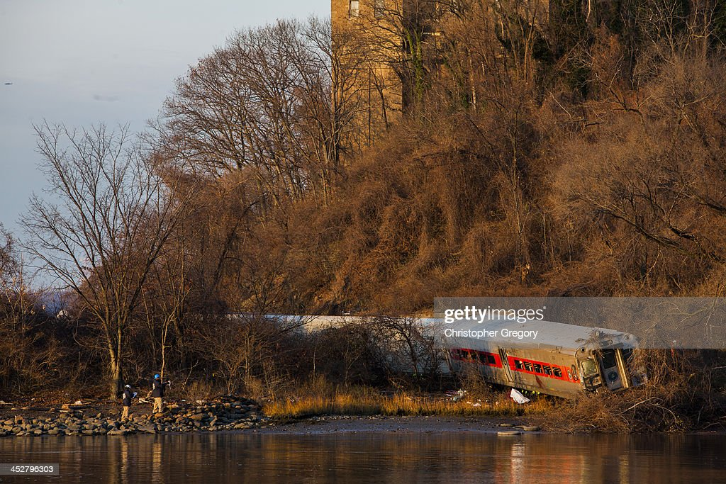 The wreckage of a MetroNorth commuter train lies on its side after it derailed just north of the Spuyten Duyvil station December 1 2013 in the Bronx...
