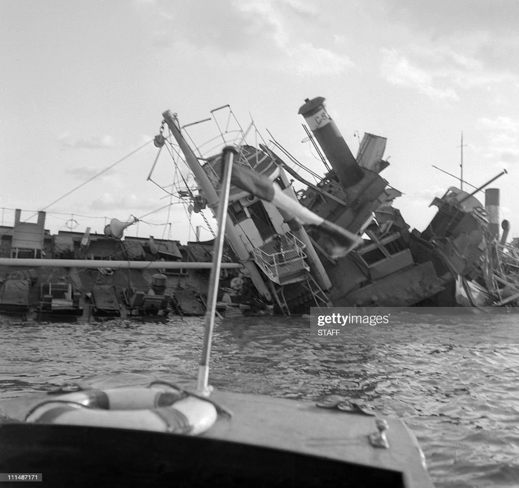 The wreckage of a ship sunk by Egyptians to block the Suez Canal appears at the surface of water 11 November 1956 in Port Saïd An AngloFrench...